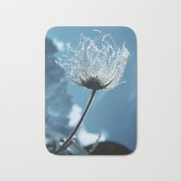 Flower shining in the light snowy mountains #1 Bath Mat