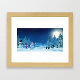 Snowman family in a moonlit winter landscape at night Framed Art Print