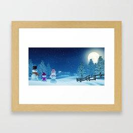 Snowman family in a moonlit winter landscape at night Framed Art Print