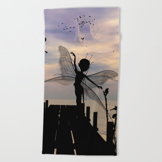 Cute fairy dancing on a jetty Beach Towel