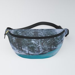 Magical river in enchanted winter forest Fanny Pack