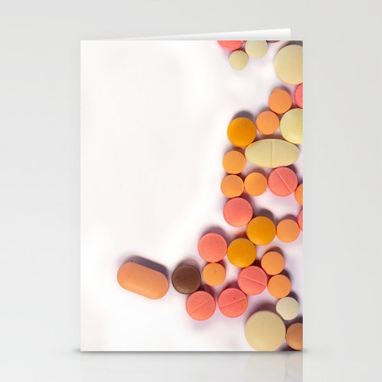 Numerous colorful pills on white background. by horacioselva