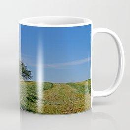 Relaxing in a field Coffee Mug