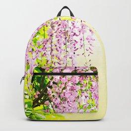 Wisteria flowers in vivid sunlight Backpack