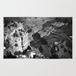 At Grand Canyon national park, USA with snow in black and white Rug