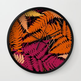 leafs tropical fern palm. orange pink brown silhouette on Black background Wall Clock