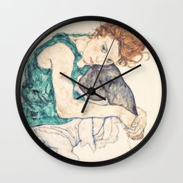 Sitting Woman With Legs Drawn Up Wall Clock