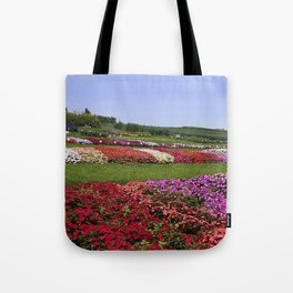 Floral patchwork under a blue sky Tote Bag