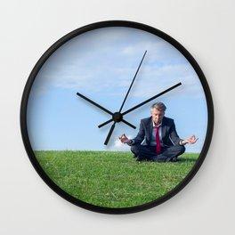Businessman practising yoga Wall Clock