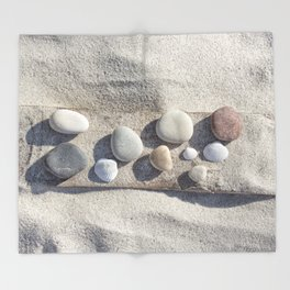 Beach pebble driftwood still life Throw Blanket
