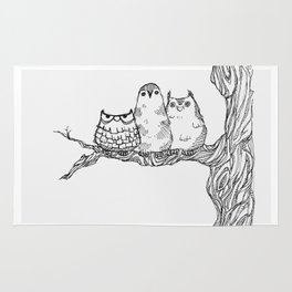 Three owls in a tree Rug