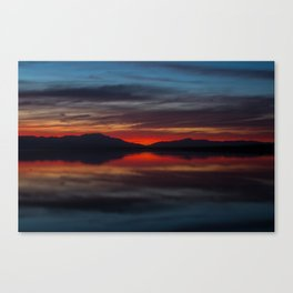 Final light of sunset turning sky and water red Canvas Print
