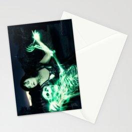 Sorceress casting spells on skeleton. Stationery Cards