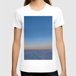 Dawn in the blue cloudless sky over the white snow ice desert of the frozen sea T-shirt