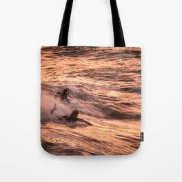 Girls catching a wave together Tote Bag