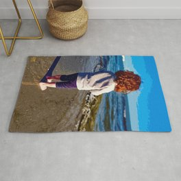 The girl who looks at the sea Rug