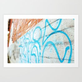 Blue graffiti on concrete wall Art Print
