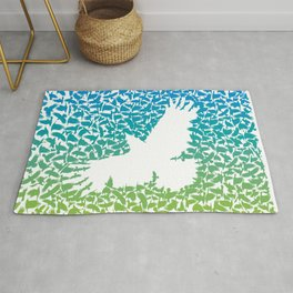 Crow from a flock of flying crows Rug