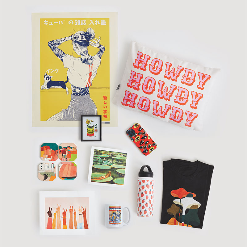 flatlay with poster, pillow, phone case, art print and more