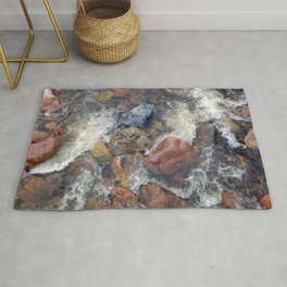 River rocks and rushing water Rug