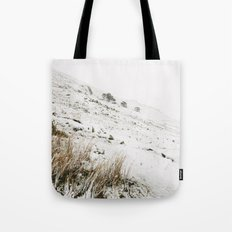 Heavy snow falling on a mountainside. Cumbria, UK. Tote Bag