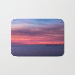 Red sunset over the ocean Bath Mat
