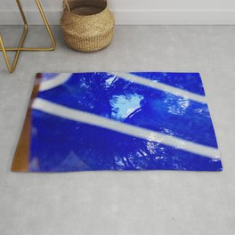 Tree reflection in blue glass Rug