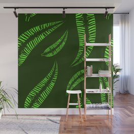 Pattern of green leaves of a palm tree on a green background. Wall Mural