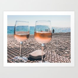 Glasses of rose wine on a beach in French Riviera Art Print