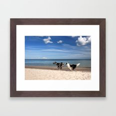 Playing dogs at the beach Framed Art Print