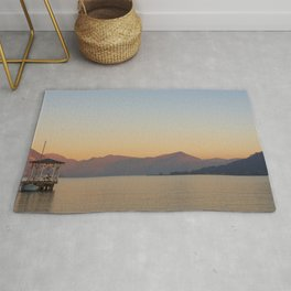 sunset over the quiet waters of Lake Iseo Rug