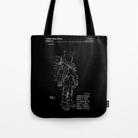 nasa Tote Bags featuring NASA Space Suit Patent - White on Black by Elegant Chaos Gallery