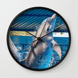 Dolphins jumping out of water on circus show Wall Clock