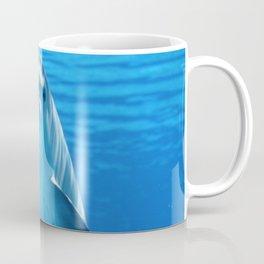 Dolphin in the ocean Coffee Mug