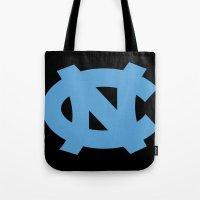 north carolina Tote Bags featuring NCAA - North Carolina Tarheels by Katieb1013