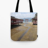 greg guillemin Tote Bags featuring Itsukushima Shrine - Greg Katz by Artlala for MSF Doctors Without Borders