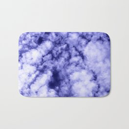 Clouds in a dark blue sky Bath Mat