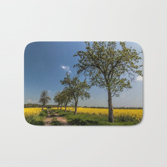Spring landscape- a trail in the rapeseed Bath Mat