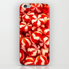 Confectionery of red and white colors with lines. Sweets two colors striped. iPhone Skin