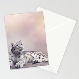 Young Snow leopard portrait resting on rock Stationery Cards