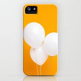 Three white balloons on yellow backdrop iPhone Case