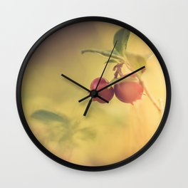 Macro shot of cowberry growing in forest Wall Clock