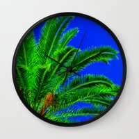 palm tree Wall Clocks featuring Palm Tree by Phil Smyth