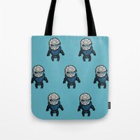garrus Tote Bags featuring Garrus: In the middle of some calibrations by Skart87