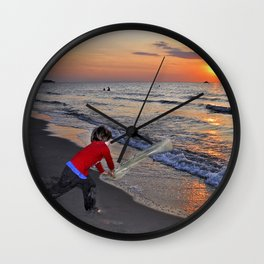 LITTLE DEVIL ON THE SUNSET BEACH Wall Clock