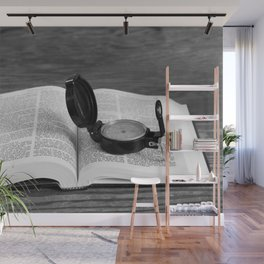 Seeking direction with open Bible and compass Wall Mural