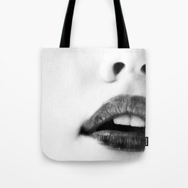 the unbearable kiss of a stranger Tote Bag