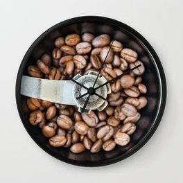 Roasted coffee beans in a manual coffee grinder. The view from the top. Wall Clock