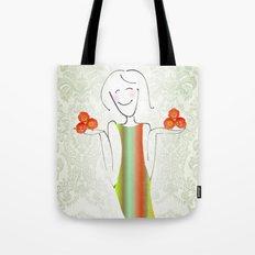 She brings tulips. Tote Bag