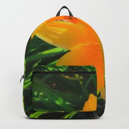 closeup yellow flower with green leaves background Backpack